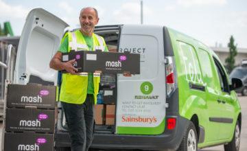 Felix Volunteer loading food from Mash onto a Renault Pro electric van